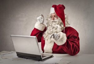 Santa typing on pc Reboot Websites